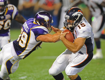 MINNEAPOLIS - SEPTEMBER 02:  Tim Tebow #15 of the Denver Broncos carries the ball and is tackled by Heath Farwell #59 of the Minnesota Vikings  during an NFL preseason game at the Mall of America Field at Hubert H. Humphrey Metrodome, on September 2, 2010