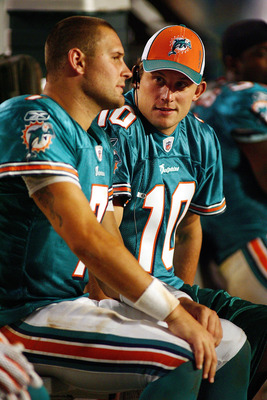 MIAMI - AUGUST 09:  Quarterback Chad Pennington #10 of the Miami Dolphins sits with quarterback Chad Henne #7 during a pre season game against the Tampa Bay Buccaneers August 9, 2008 at Dolphin Stadium in Miami, Florida.  (Photo by Marc Serota/Getty Image