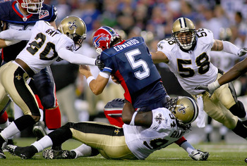 ORCHARD PARK, NY - SEPTEMBER 27: Randal Gay #24, Charles Grant #94 and Scott Shanlee #58  of the New Orleans Saints combine to sack Trent Edwards #5 of the Buffalo Bills  at Ralph Wilson Stadium on September 27, 2009 in Orchard Park, New York.  The Saints