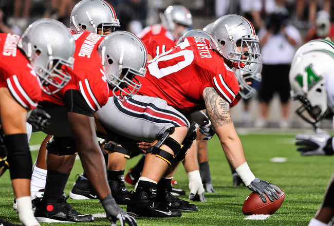 COLUMBUS, OH - SEPTEMBER 2: Michael Brewster #50 of the Ohio State Buckeyes gets ready to snap the ball against the Marshall Thundering Herd at Ohio Stadium on September 2, 2010 in Columbus, Ohio. (Photo by Jamie Sabau/Getty Images)