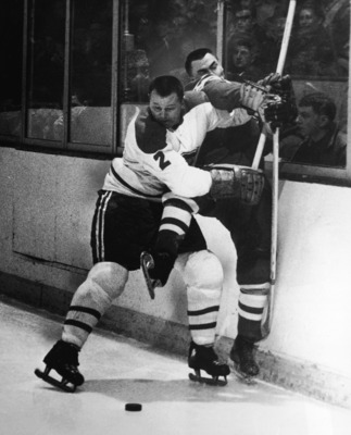 Canadian professional hockey player Doug Harvey of the Montreal Canadiens slams an opponent against the boards to keep him away from the puck, 1950s. (Photo by Pictorial Parade/Getty Images)