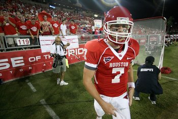 HOUSTON - SEPTEMBER 26:  Quarterback Case Keenum #7 of the Houston Cougars walks on the files before playing against the Texas Tech Red Raiders at Robertson Stadium on September 26, 2009 in Houston, Texas.  (Photo by Thomas B. Shea/Getty Images)