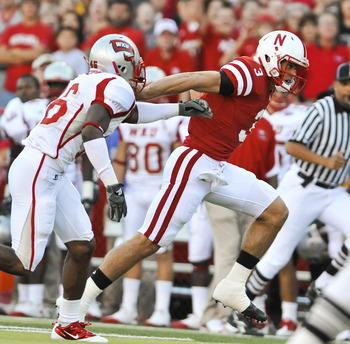 LINCOLN, NE - SEPTEMBER 04:  Taylor Matinez  #3 of the Nebraska Cornhuskers scores his first touchdown as a Cornhusker during the first half of  their game against the Western Kentucky Hilltoppers at Memorial Stadium on September 4, 2010 in Lincoln, Nebra