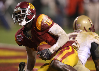 SAN FRANCISCO - DECEMBER 26: Damian Williams #18 of the USC Trojans scores a touchdown against the Boston College Eagles during the 2009 Emerald Bowl at AT&T Park on December 26, 2009 in San Francisco, California. (Photo by Jed Jacobsohn/Getty Images)