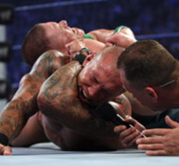 Bragging Rights match. To Orton with handcuffs! OUCH!