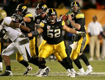 MIAMI GARDENS, FL - JANUARY 05:  Center Rafael Eubanks #52 of the Iowa Hawkeyes pass protects for quarteback Ricky Stanzi against the Georgia Tech Yellow Jackets during the FedEx Orange Bowl at Land Shark Stadium on January 5, 2010 in Miami Gardens, Flori