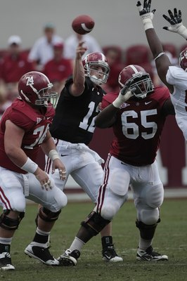 TUSCALOOSA, AL - APRIL 17: Quarterback Greg McElroy #12 of the University of Alabama throws during the Alabama spring game at Bryant Denny Stadium on April 17, 2010 in Tuscaloosa, Alabama. (Photo by Dave Martin/Getty Images)