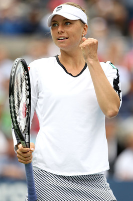 NEW YORK - SEPTEMBER 10:  Vera Zvonareva of Russia celebrates after defeating Caroline Wozniacki of Denmark during her women's semifinal match on day twelve of the 2010 U.S. Open at the USTA Billie Jean King National Tennis Center on September 10, 2010 in