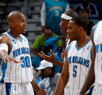 NEW ORLEANS - MARCH 08:  Darius Songalia #9, David West #30, James Posey #41 and Marcus Thornton #5 of the New Orleans Hornets talk during a timeout against the Golden State Warriors at New Orleans Arena on March 8, 2010 in New Orleans, Louisiana.  The Ho