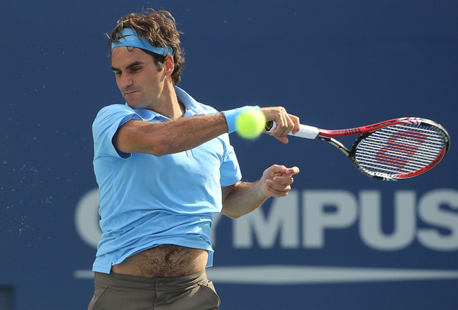 NEW YORK - SEPTEMBER 04:  Roger Federer of Switzerland returns a shot against Paul-Henri Mathieu of France during the men's singles match on day six of the 2010 U.S. Open at the USTA Billie Jean King National Tennis Center on September 4, 2010 in the Flus