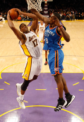 LOS ANGELES, CA - NOVEMBER 22:  Andrew Bynum #17 of the Los Angeles Lakers drives to the basket past Serge Ibaka #9 of the Oklahoma City Thunder in the first half at Staples Center on November 22, 2009 in Los Angeles, California. The Lakers defeated the T