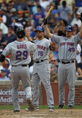 CHICAGO - SEPTEMBER 05: Carlos Beltran #15 and Jonathan Niese #49 of the New York Mets greet teammate Ike Davis #29 after Beltran and Davis scored runs against the Chicago Cubs in the 5th inning at Wrigley Field on September 5, 2010 in Chicago, Illinois.