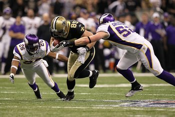 NEW ORLEANS - JANUARY 24:  David Thomas #85 of the New Orleans Saints runs for yards after the catch against Antoine Winfield #26 and Chad Greenway #52 of the Minnesota Vikings during the NFC Championship Game at the Louisiana Superdome on January 24, 201