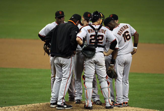 SAN DIEGO, CA - SEPTEMBER 10:  Members of the San Francisco Giants huddle around Starting Pitcher Jonathan Sanchez #57 during their MLB game against he San Diego Padres on September 10, 2010 at Petco Park in San Diego, California. (Photo by Donald Miralle