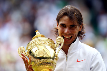LONDON, ENGLAND - JULY 04:  Rafael Nadal of Spain holds the Championship trophy after winning the Men's Singles Final match against Tomas Berdych of Czech Republic on Day Thirteen of the Wimbledon Lawn Tennis Championships at the All England Lawn Tennis a