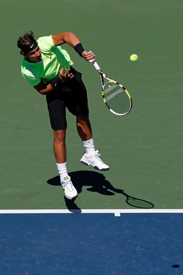 NEW YORK - SEPTEMBER 11:  Rafael Nadal of Spain serves against Mikhail Youzhny of Russia during his men's singles semifinal match on day thirteen of the 2010 U.S. Open at the USTA Billie Jean King National Tennis Center on September 11, 2010 in the Flushi