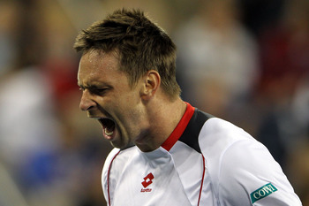 NEW YORK - SEPTEMBER 08:  Robin Soderling of Sweden reacts against Roger Federer of Switzerland during his men's singles quarterfinal match on day ten of the 2010 U.S. Open at the USTA Billie Jean King National Tennis Center on September 8, 2010 in the Fl