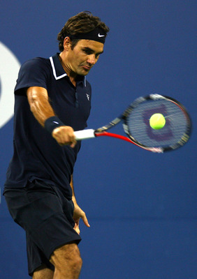 NEW YORK - SEPTEMBER 08:  Roger Federer of Switzerland returns a shot against Robin Soderling of Sweden during his men's singles quarterfinal match on day ten of the 2010 U.S. Open at the USTA Billie Jean King National Tennis Center on September 8, 2010 i