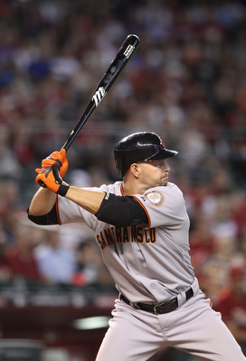 PHOENIX - SEPTEMBER 06:  Cody Ross #13 of the San Francisco Giants at bat during the Major League Baseball game against the Arizona Diamondbacks at Chase Field on September 6, 2010 in Phoenix, Arizona. The Giants defeated the Diamondbacks 2-0 in eleven in