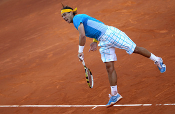 MADRID, SPAIN - MAY 16:  Rafael Nadal of Spain serves against Roger Federer of Switzerland in the mens final match during the Mutua Madrilena Madrid Open tennis tournament at the Caja Magica on May 16, 2010 in Madrid, Spain.  (Photo by Clive Brunskill/Get