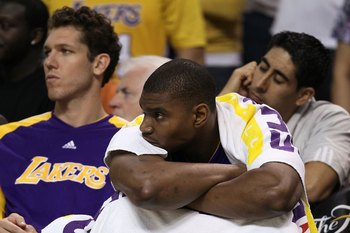 BOSTON - JUNE 10:  Andrew Bynum #17 and Luke Walton #4 (L) of the Los Angeles Lakers sit on the bench near the end of the Lakers' loss to the Boston Celltics during Game Four of the 2010 NBA Finals on June 10, 2010 at TD Garden in Boston, Massachusetts. N