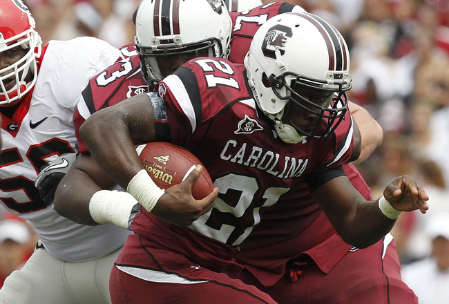 COLUMBIA - SEPTEMBER 11: Tailback Marcus Lattimore #21 of the South Carolina Gamecocks runs with the ball against the Georgia Bulldogs at Williams-Brice Stadium on September 11, 2010 in Columbia, South Carolina. (Photo by Mike Zarrilli/Getty Images)