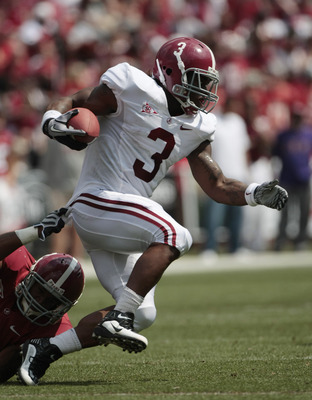TUSCALOOSA, AL - APRIL 17:  Running back Trent Richardson #3 of the University of Alabama Crimson Tide runs for a first down during the Alabama spring game at Bryant Denny Stadium on April 17, 2010 in Tuscaloosa, Alabama. (Photo by Dave Martin/Getty Image