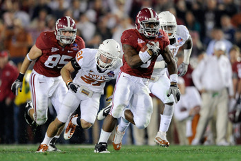 PASADENA, CA - JANUARY 07:  Running back Trent Richardson #3 of the Alabama Crimson Tide runs for a 49-yard touchdown against the Texas Longhorns in the second quarter of the Citi BCS National Championship game at the Rose Bowl on January 7, 2010 in Pasad