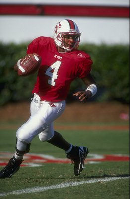 12 Sep 1998:  Quarterback Jamie Barnette #4 of the North Carolina State Wolfpack runs back and looks to throw during the game against the  Florida State University Seminals at Carter Finley Stadium in Raleigh, North Carolina. North Carolina State defeated
