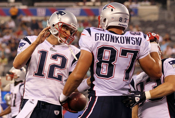 EAST RUTHERFORD, NJ - SEPTEMBER 02:  Tom Brady #12 and Rob Gronkowski #87 of the New England Patriots celebrate after teaming up for a first quarter touchdown against the New York Giants on September 2, 2010 at the New Meadowlands Stadium in East Rutherfo