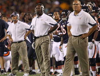 CHICAGO - AUGUST 28: Head coach Lovie Smith of the Chicago Bears (C) watches along with defensive coorindator Rod Marinelli (L) and special teams coordinator Dave Toub (R) as their team takes on the Arizona Cardinals during a preseason game at Soldier Fie