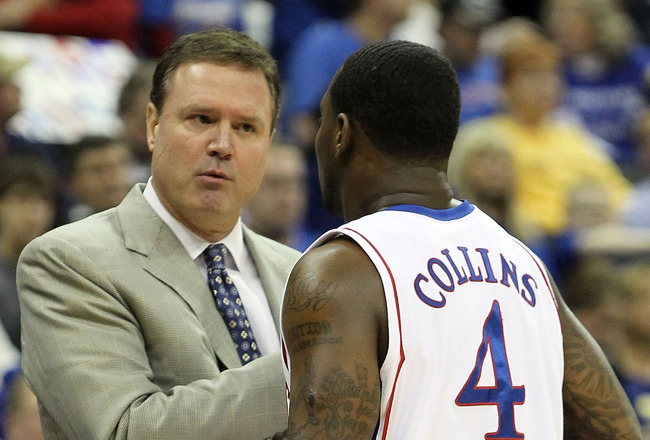 KANSAS CITY, MO - MARCH 11:  Head coach Bill Self of the Kansas Jayhawks talks with Sherron Collins #4 in the first half while taking on the Texas Tech Red Raiders during the quarterfinals of the 2010 Phillips 66 Big 12 Men's Basketball Tournament at the