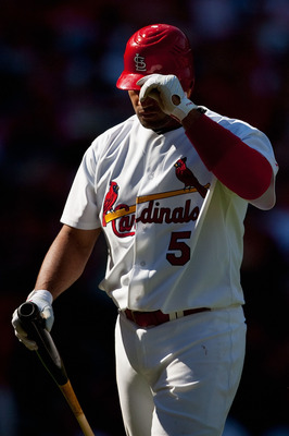 ST. LOUIS - SEPTEMBER 5: Albert Pujols #5 of the St. Louis Cardinals returns to the dugout after striking out against the Cincinnati Reds at Busch Stadium on September 5, 2010 in St. Louis, Missouri.  The Cardinals beat the Reds 4-2.  (Photo by Dilip Vish
