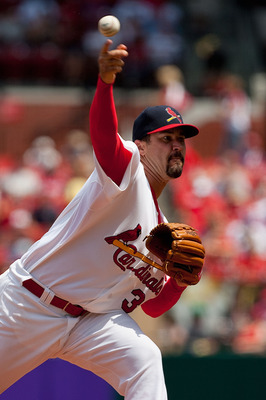 ST. LOUIS - JULY 18: Starting pitcher Jeff Suppan #37 of the St. Louis Cardinals thows against the Los Angeles Dodgers at Busch Stadium on July 18, 2010 in St. Louis, Missouri.  The Cardinals beat the Dodgers 5-4.  (Photo by Dilip Vishwanat/Getty Images)