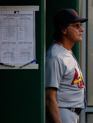 PITTSBURGH - AUGUST 25:  Manager Tony LaRussa #10 of the St. Louis Cardinals watches his team play against the Pittsburgh Pirates during the game on August 25, 2010 at PNC Park in Pittsburgh, Pennsylvania.  (Photo by Jared Wickerham/Getty Images)
