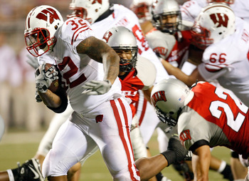 LAS VEGAS - SEPTEMBER 04:  John Clay #32 of the Wisconsin Badgers runs for a touchdown agains the UNLV Rebels during the third quarter of their game at Sam Boyd Stadium September 4, 2010 in Las Vegas, Nevada. Wisconsin won 41-21.  (Photo by Ethan Miller/G
