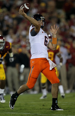 LOS ANGELES, CA - SEPTEMBER 11:  Quarterback Marc Verica #6 of the Virginia Cavaliers throws a pass against the USC Trojans at Los Angeles Memorial Coliseum on September 11, 2010 in Los Angeles, California. USC won 17-14.  (Photo by Stephen Dunn/Getty Ima