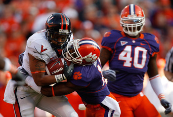 CLEMSON, SC - NOVEMBER 21:  Jameel Sewell #10 of the Virginia Cavaliers is tackled by Kavell Conner #17 of the Clemson Tigers during their game at Memorial Stadium on November 21, 2009 in Clemson, South Carolina.  (Photo by Streeter Lecka/Getty Images)