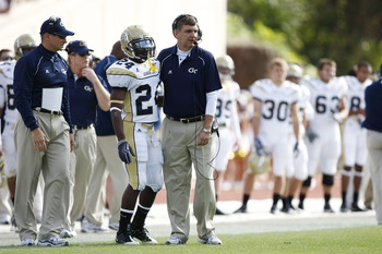 DURHAM, NC - NOVEMBER 14:  Head coach Paul Johnson of the Georgia Tech Yellow Jackets gives instructions to Embry Peeples #24 during the game against the Duke Blue Devils at Wallace Wade Stadium on November 14, 2009 in Durham, North Carolina. (Photo by Jo