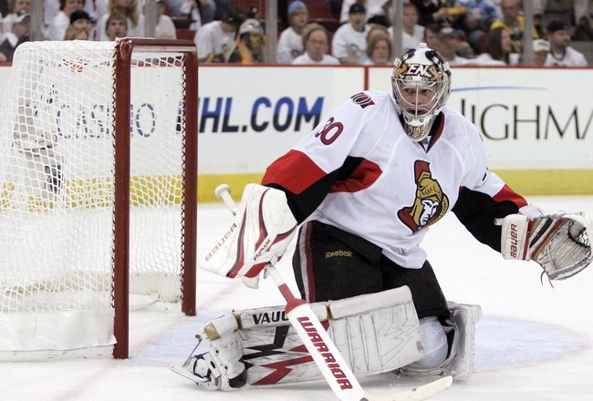 PITTSBURGH - APRIL 16:  Brian Elliott #30 of the Ottawa Senators eyes the puck in the corner against the Pittsburgh Penguins in Game Two of the Eastern Conference Quarterfinals during the 2010 NHL Stanley Cup Playoffs at Mellon Arena on April 16, 2010 in