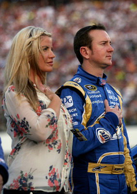 RICHMOND, VA - MAY 01:  Kurt Busch, driver of the #2 Miller Lite Dodge, stands with his wife Eva on the grid prior to the start of the the NASCAR Sprint Cup Series Crown Royal Presents the Heath Calhoun 400 at Richmond International Raceway on May 1, 2010