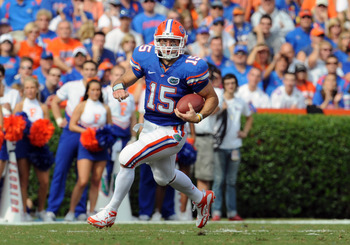 GAINESVILLE, FL - NOVEMBER 21: Quarterback Tim Tebow #15 of the Florida Gators rushes upfield against the Florida International University Golden Panthers, November 21, 2009 at Ben Hill Griffin Stadium in Gainesville, Florida.  (Photo by Al Messerschmidt/