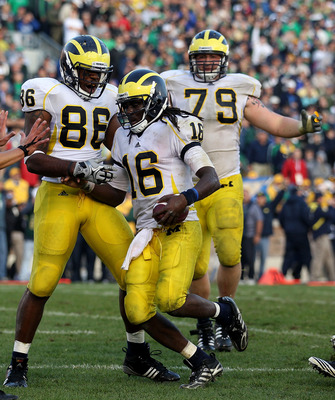 SOUTH BEND, IN - SEPTEMBER 11: Kevin Koger #86 and Perry Dorrestein #79 of the Michigan Wolverines celebrate with Denard Robinson #16 after Robinson scored the game-winning touchdown against against the Notre Dame Fighting Irish at Notre Dame Stadium on S