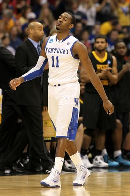 SYRACUSE, NY - MARCH 27:  John Wall #11 of the Kentucky Wildcats walks towards the bench against the West Virginia Mountaineers during the east regional final of the 2010 NCAA men's basketball tournament at the Carrier Dome on March 27, 2010 in Syracuse,