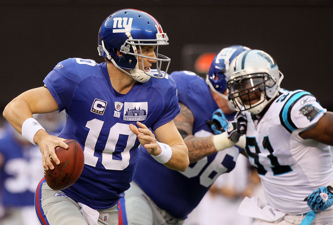 EAST RUTHERFORD, NJ - SEPTEMBER 12:  Eli Manning #10 of the New York Giants looks to throw a pass against the Carolina Panthers on September 12, 2010 at the New Meadowlands Stadium in East Rutherford, New Jersey.  (Photo by Jim McIsaac/Getty Images)