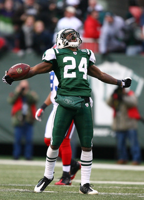 EAST RUTHERFORD, NJ - DECEMBER 14:  Darrelle Revis #24 of the New York Jets celebrates making a game saving interception in the closing minutes of regulation preserving a 31-27 win against the Buffalo Bills during their game on December 14, 2008 at Giants