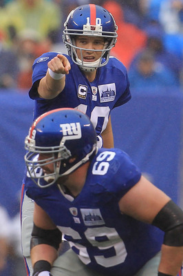 EAST RUTHERFORD, NJ - SEPTEMBER 12:  Eli Manning #10 of the New York Giants gives instructions against the Carolina Panthers during the NFL season opener at New Meadowlands Stadium on September 12, 2010 in East Rutherford, New Jersey.  (Photo by Chris McG