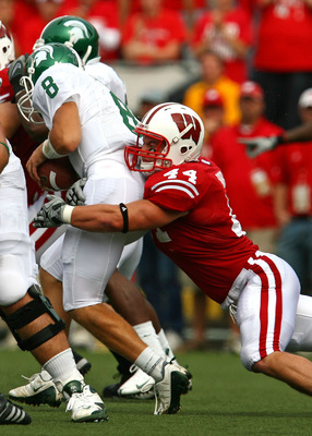 MADISON, WI - SEPTEMBER 26: Chris Borland #44 of the Wisconsin Badgers sacks Kirk Cousins #8 of the Michigan State Spartans on September 26, 2009 at Camp Randall Stadium in Madison, Wisconsin. Wisconsin defeated Michigan State 38-30. (Photo by Jonathan Da
