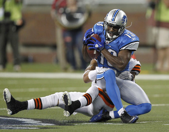 DETROIT - AUGUST 28:  Nate Burleson #13 of the Detroit Lions tries to escape the tackle of Eric Wright #21 of the Cleveland Browns in a preseason game on August 28, 2010 at Ford Field in Detroit, Michigan.  (Photo by Gregory Shamus/Getty Images)