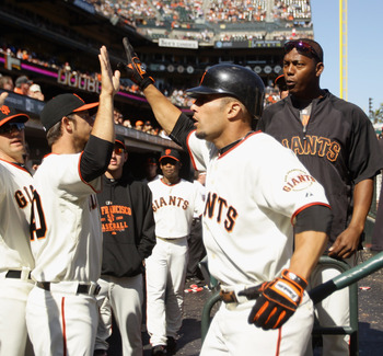 SAN FRANCISCO - AUGUST 29:  Andres Torres #56 of the San Francisco Giants is congratulated by teammates after he scored to give the Giants a 9-7 lead in the eighth inning of their game against the Arizona Diamondbacks at AT&T Park on August 29, 2010 in Sa